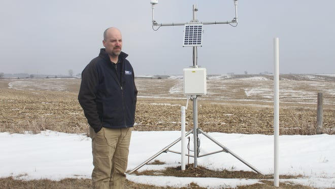 Jim Niemeier, University of Iowa research engineer, explains the Iowa Flood Center's new weather station during a news conference Wednesday, March 28. This station, located on the Stewart Maas farm south of South Amana, is one of about 20 currently in place statewide.