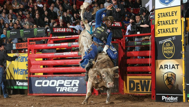 Cody Nance rides More Big Bucks for 89 during the third round of the Albuquerque PBR 25th Anniversary Unleash the Beast.