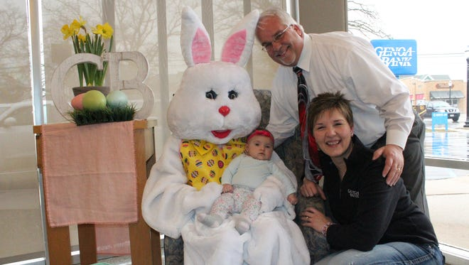 Marty Sutter, with wife Amy Sutter, and granddaughter, Amelia Sutter pose with the Easter Bunny at GenoaBank's Genoa branch location.