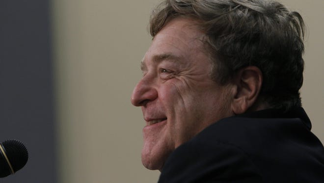 John Goodman laughs during a press conference after a convocation at Missouri State University.