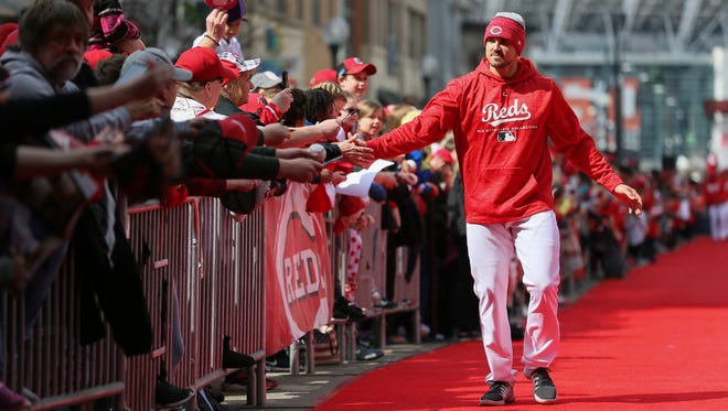 Cincinnati Reds left fielder Adam Duvall (23) high fives fans on the red carpet as part of Kids Opening Day Festivities, Saturday, March 31, 2018, at Great American Ball Park in Cincinnati.