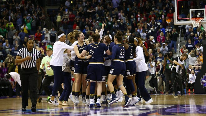 Mar 30, 2018; Columbus, OH, USA; The Notre Dame Fighting Irish players celebrate after the buzzer sounded defeating the Connecticut Huskies in overtime in the semifinals of the women's Final Four in the 2018 NCAA Tournament at Nationwide Arena. Mandatory Credit: Aaron Doster-USA TODAY Sports