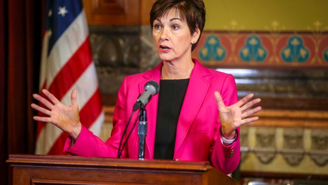 Gov. Kim Reynolds holds a press conference after signing a bill allowing unregulated health plans Monday, April 2, 2018, at the Iowa Statehouse.