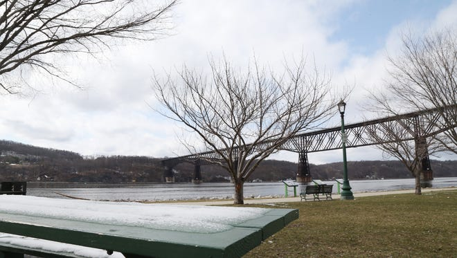 Snow melts from a picnic table in Waryas Park in the City of Poughkeepsie on April 2, 2018.