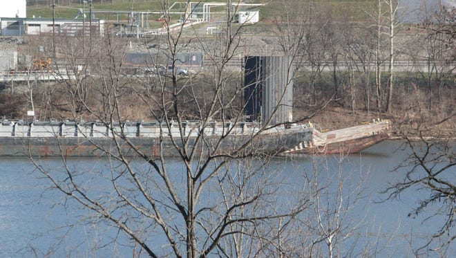 A barge owned by Southern Towing buckled in the Ohio River on Dec. 19, 2017.