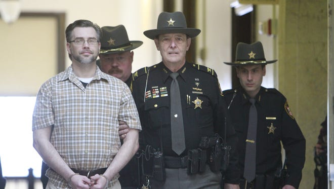Ashland County Sheriff Chief Deputy Carl Richert escorts Shawn M. Grate from the elevator on the second floor to his appearance in Common Pleas Court Monday, March 5, 2018 for a hearing to hear juror excuse from jury duty requests.