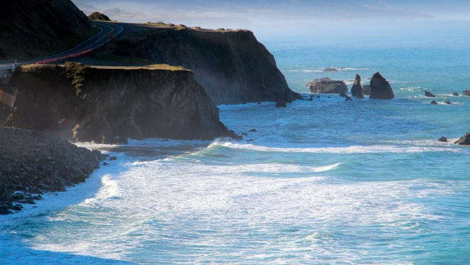 This March file photo shows the scene of the fatal crash on the Mendocino coast near Mendocino, Calif., where the SUV carrying the Hart family off a cliff, killing all passengers. Now, rescuers are searching for another family who is believed to have crashed nearby.