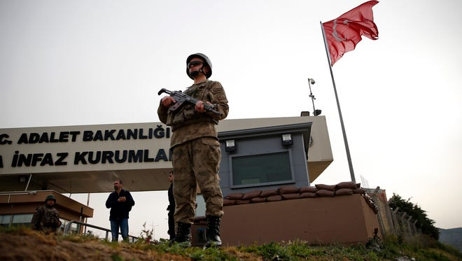 Members of Turkish forces guard the entrance to the prison complex in Aliaga, Izmir province, western Turkey, where jailed US pastor Andrew Brunson is held and appeared Monday on his trial at a court inside the complex.