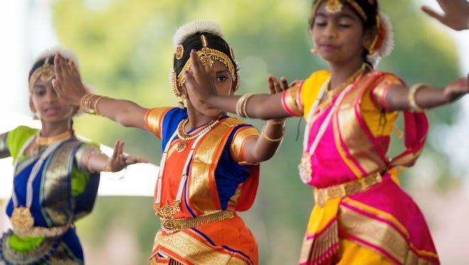 Sandra Jose, center, 10, dances a traditional Diwali dance during a festival.