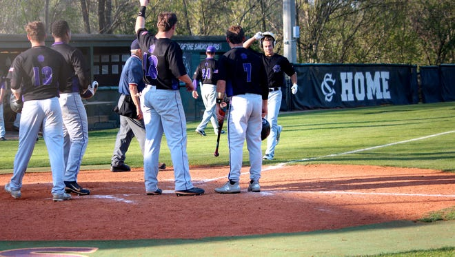 Sevier County center fielder Kenny Naysmith's teammates celebrate his home run against Daniel Boone on Friday, April 13, 2018.