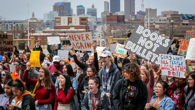 Hundreds of Iowa students walked out of school Friday, April 20, 2018, in Des Moines, Iowa, to call on lawmakers to take action to prevent gun violence. The walkouts mirrored others held in March across the U.S. after the deadly shooting in Parkland, Florida, that killed 17 people.