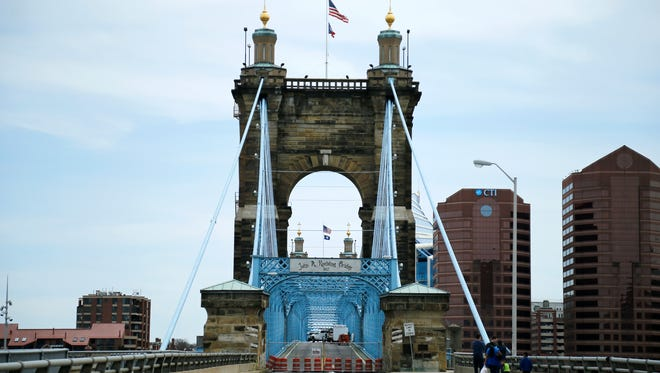 The John A. Roebling Suspension Bridge spanning the Ohio River between Covington, Ky., and downtown Cincinnati on Saturday, April 21, 2018.