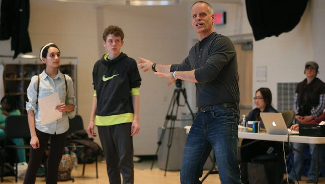 The United Performing Arts Fund announced a $250,000 gift to First Stage for use in expanding its home, the Milwaukee Youth Arts Center. In this 2018 photo at MYAC, First Stage artistic director Jeff Frank (right) coaches teenage actors Abby Hanna (left) and Liam Jeninga.