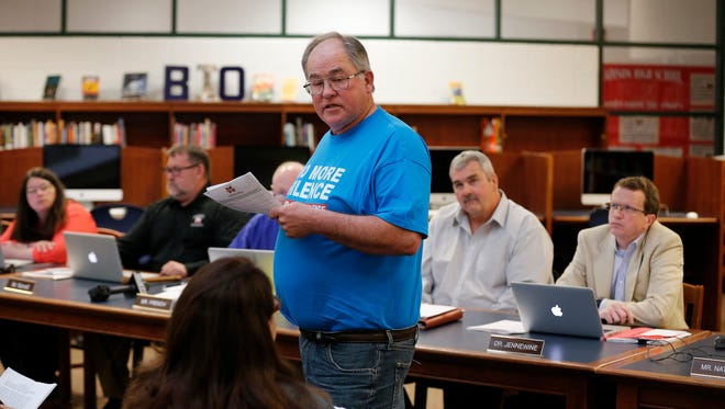 Billy Ison makes a statement against arming teachers during a meeting of the school board at Madison Jr./Sr. High School in Madison Twp., Ohio, on Tuesday, April 24, 2018. The school board voted unanimously to approve arming educators inside of schools.
