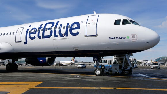 A JetBlue Airways plane is shown April 19, 2018 at