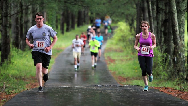 Runners follow The Oaks Greenway for part of the Britten Strong Race to Recovery held at Montreat College's Black Mountain campus in 2018.