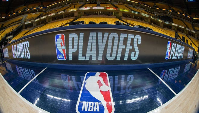 Apr 27, 2018; Indianapolis, IN, USA; A general view of the NBA logo and the playoffs scorer table before game six between the Indiana Pacers and the Cleveland Cavaliers in the first round of the 2018 NBA Playoffs at Bankers Life Fieldhouse. Mandatory Credit: Trevor Ruszkowski-USA TODAY Sports