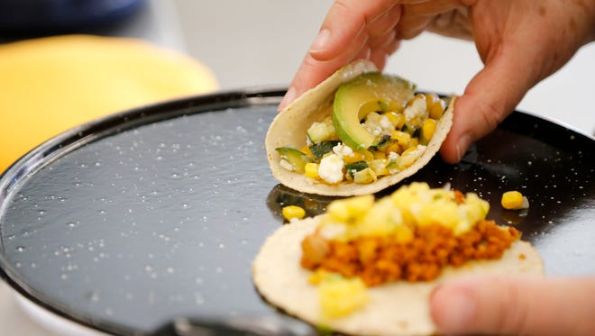 A pair of tacos by Lety Sanchez is served at Findlay Kitchen in the Over-the-Rhine neighborhood of Cincinnati on Friday, April 20, 2018.