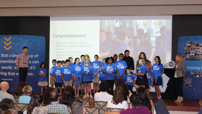 "Students at Gulf Coast Charter Academy South celebrate receiving ""Healthy School Award"" from the Blue Zones Project recently."