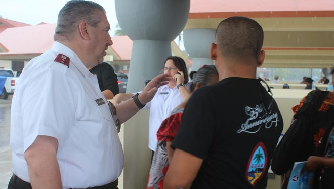 A Salvation Army official directs attendees at the 11th Annual Passport To Services/Stand Down event.