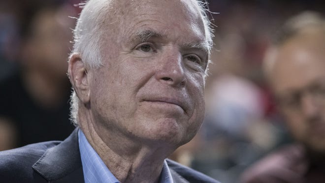Sen. John McCain attends the Arizona Diamondbacks and Los Angeles Dodgers game with his family on Aug. 10, 2017 at Chase Field in Phoenix.