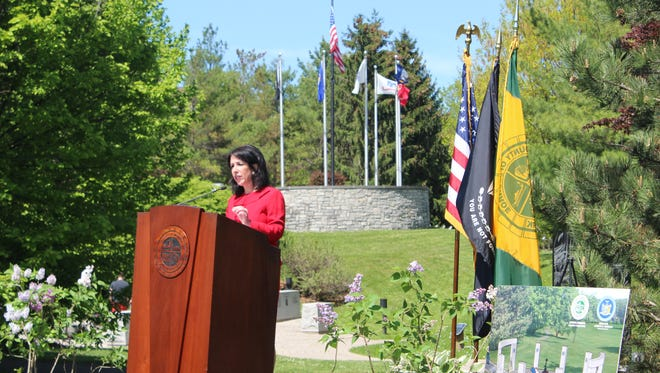 Monroe County Executive Cheryl Dinolfo announces funding for the Warriors of Freedom Memorial at Highland Park Friday.