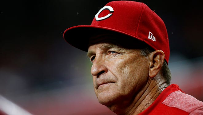 Cincinnati Reds interim manager Jim Riggleman (35) watches from the top of the stairs in the top of the second inning of the MLB National League game between the Cincinnati Reds and the Chicago Cubs at Great American Ball Park in downtown Cincinnati on Friday, May 18, 2018. After three innings the Cubs led 4-0.