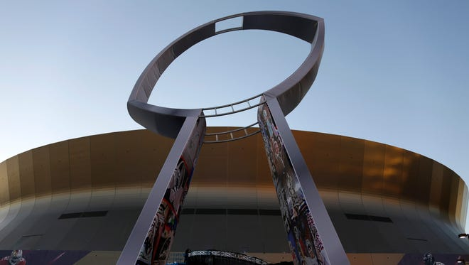 A statue depicting the Vince Lombardi Super Bowl Trophy stands outside the Mercedes-Benz Superdome back when New Orleans hosted the Super Bowl in 2013.