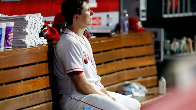 Cincinnati Reds starting pitcher Homer Bailey (34) talks to himself on the bench after leaving the game in the top of the sixth inning of the MLB National League game between the Cincinnati Reds and the Pittsburgh Pirates at Great American Ball Park in downtown Cincinnati on Wednesday, May 23, 2018. The Reds lost 5-4 in 12 innings.
