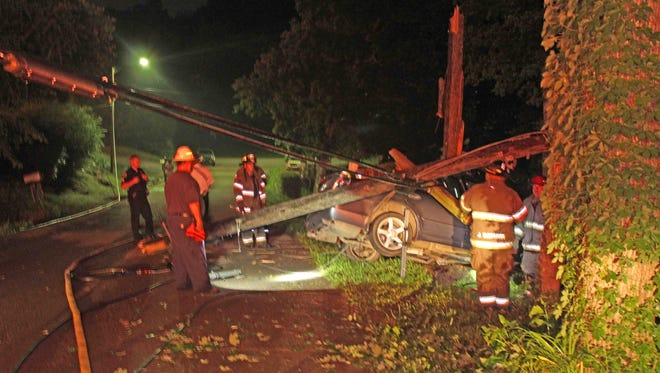 This car crashed on Oak Street early Saturday morning, smashing the utility pole into three pieces.