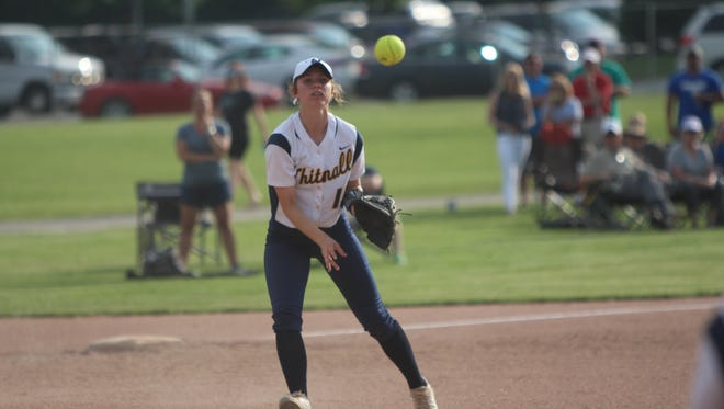 Whitnall's Elizabeth Vedbraaten throws to first base to record an out in a sectional semifinal against New Berlin West on May 29, 2018.