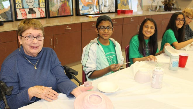 Monroe students paired with local seniors at the Monroe Township Senior Center in April to decorate ceramic bowls, an activity leading up to the June 6 Empty Bowls Auction.