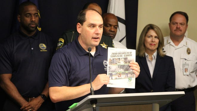 Leon County Emergency Management Director Kevin Peters holds the 2018 Disaster Survival Guide.