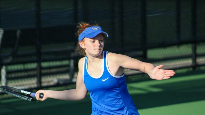 Burris' Isabelle Behrman waits to hit a forehand during a match this season. A sophomore, Behrman will be competing in the individual state tournament.
