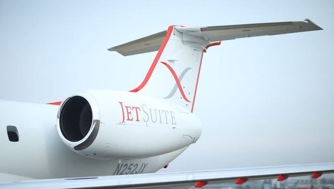 A shot of the engine of a JetSuiteX Embraer ERJ135 jet.