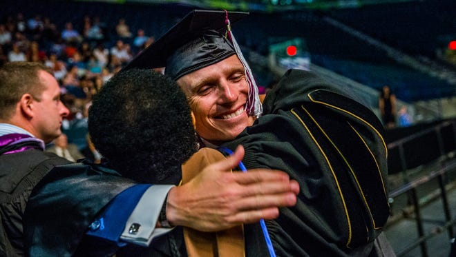 Matthew Doyle is congratulated during the commencement ceremony for Hodges University at Germain Arena in Estero on Sunday, June 10, 2018. Doyle works with the Naples Police Department and he was an Army Ranger with the 1st Battalion 75th Ranger Regiment until 2004.