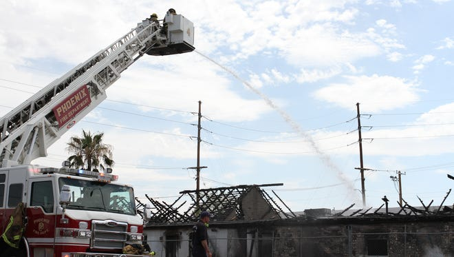 The Phoenix Fire Department responded to a fire in a vacant building next to apartments Wednesday.