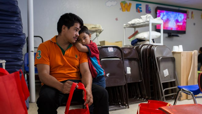 Genin Rodas, 29, and son is Edison Rodas, 5, from Sabá, Honduras, embrace each other as they wait for a family member to buy them a bus ticket after being released by U.S. Immigration officials May 7, 2018, at the Catholic Charities Rio Grande Valley refugee center in McAllen, Texas.