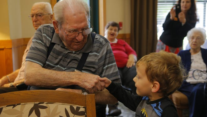Middle school aged children and younger visited Sunrise Villa Salinas, a residential facility, to deliver hats and cards to senior men for the I Remember PAPA event to commemorate Father's Day.