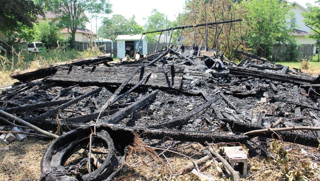 Fire investigators have yet to determine the cause of a Saturday morning blaze that destroyed an abandoned two-car garage on Silver Street.