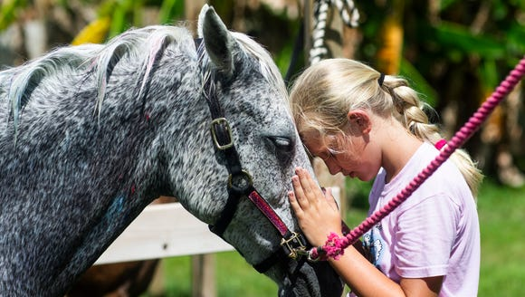 Lily Nagel, 9, shares a moment with Penny the pony