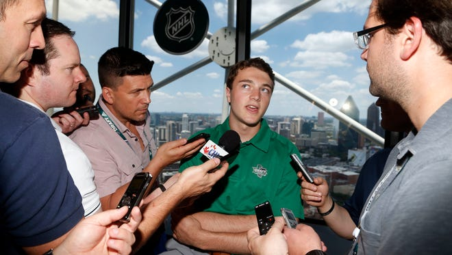 Noah Dobson talks to the media in Dallas, Thursday.