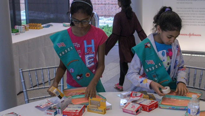 New Brunswick Girl Scout Troops visit the Johnson & Johnson museum for a private tour, followed by a custom first aid kit building on June 27 to celebrate the 130th anniversary of the first aid kit.