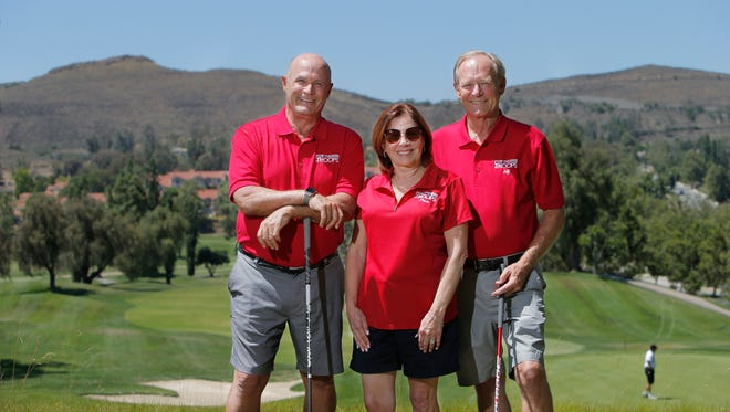 Paula Cornell, president of For the Troops, poses for a photo with Bruce Beck, left, and Jeff Berg on a hill overlooking the ninth green at Wood Ranch Golf Club in Simi Valley. Beck and Berg are on the planning committee for the eighth annual Heroes Golf Tournament, a For the Troops fundraiser.