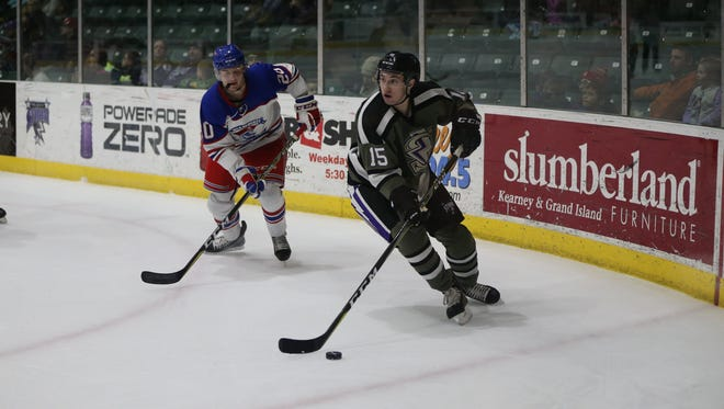 Tri-City Storm forward Sam Hentges (15) carries the puck toward the net as Des Moines' Erik Urbank (20) pursues. Hentges had eight goals and 10 assists in 23 games in the United States Hockey League last season for Tri-City and Des Moines.