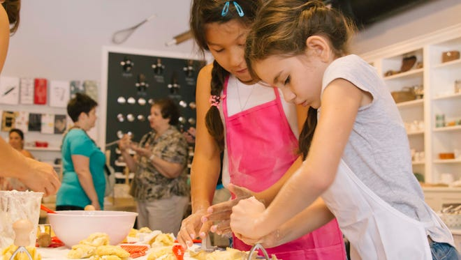 Kids learn to make pizza and cookies at MESA: A Collaborative Kitchen in New Albany, Indiana.