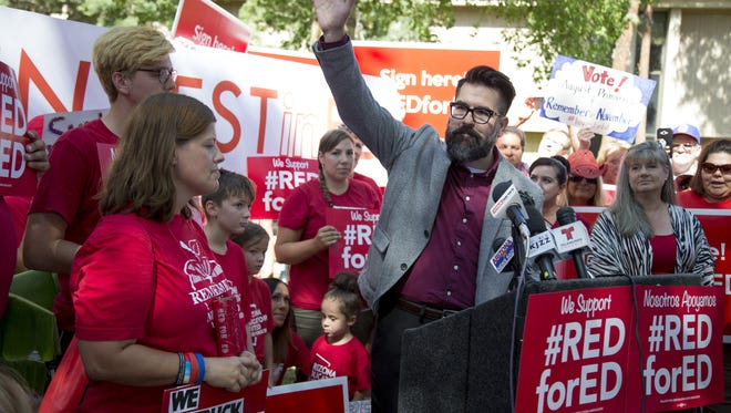 Red Mountain High School teacher Josh Buckley speaks July 5, 2018, during a press conference at the state capitol in Phoenix to announce the Invest In Education campaign had collected 270,000 signatures to get its education funding initiative on the ballot.