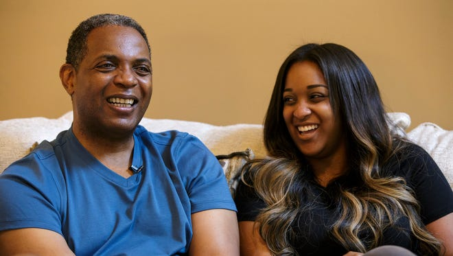 Former Cincinnati Bengals kick returner Stanford Jennings laughs with his daughter Kelsey as he recalls the story of her being born just before the Bengals played in the 1989 Super Bowl at his home in Alpharetta, Ga., on Monday, June 25, 2018.