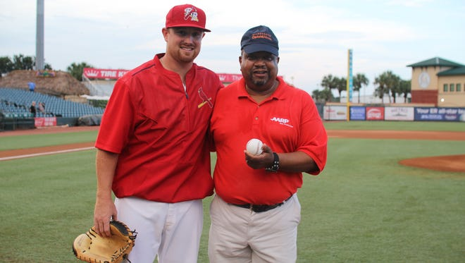 Ken Thomas, at right, Regional Volunteer director at AARP Florida, threw out the first pitch at the Palm Beach Cardinals' Opioid Abuse Awareness Night, presented in partnership with Allied Against Opioid Abuse.