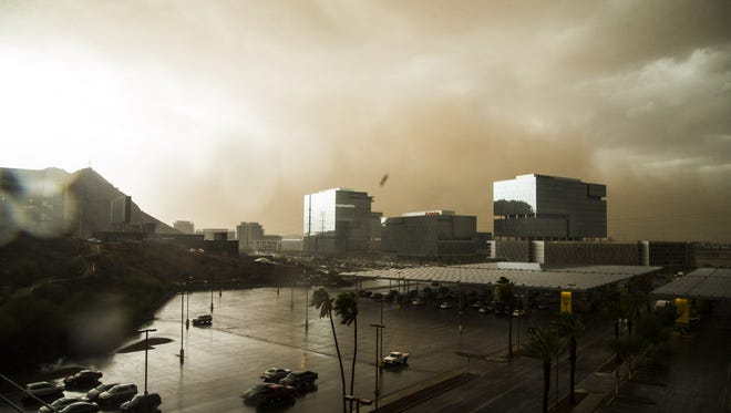 A dust storm passes the north side of Tempe, Ariz. on July 9, 2018.
